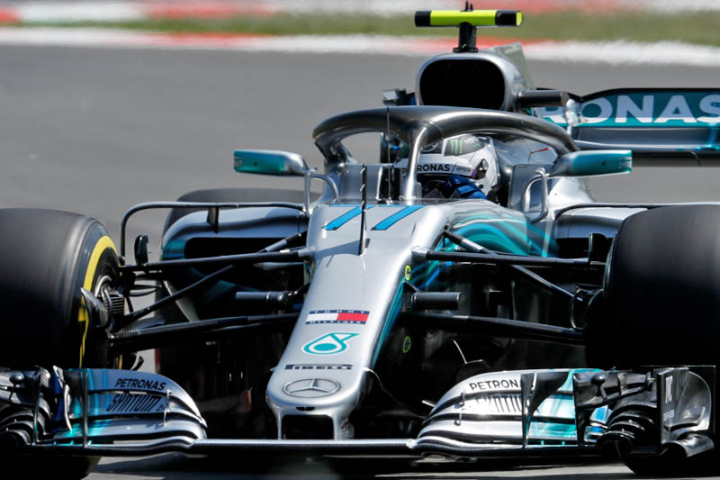 Hamilton hottest again in eventful second practice