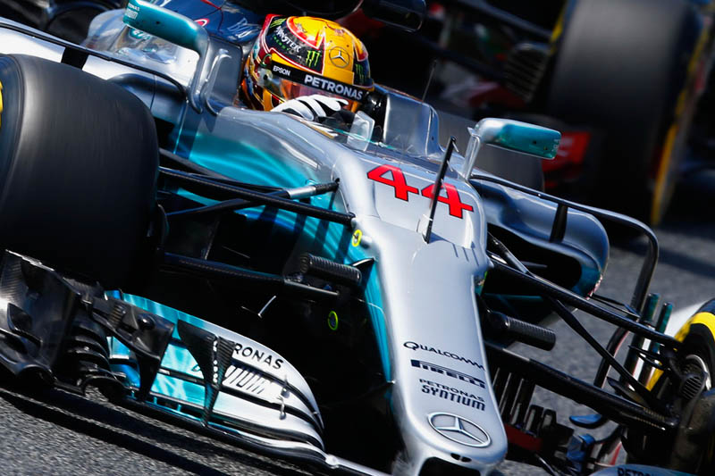 Vettel flies in Monaco as Hamilton labours