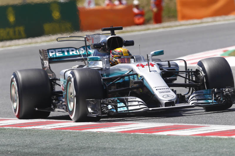 Lewis Hamilton roars into pole position
