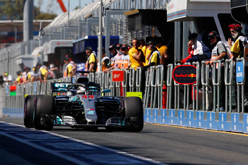Hamilton breaks records to take pole in Melbourne
