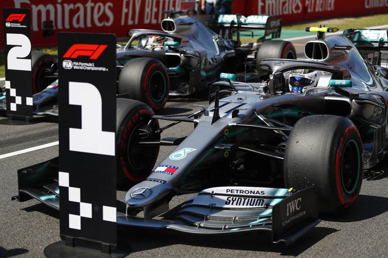 Hamilton claims Spanish Grand Prix to go top