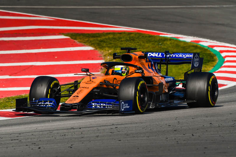 Three members of the Mc Laren team had to be treated after a fire broke out in the team's garage during a filming day at Barcelona